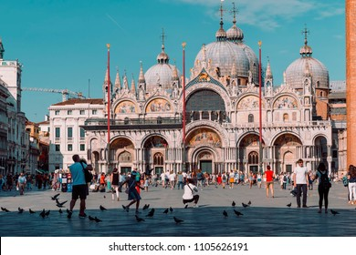 Italy, Venezia - 05.21.2018: St. Mark's square (San Marco) is the tourist heart of Venice with iconic sights of St. Mark's basilica, campanile (cathedral tower) and Doge's Palace
