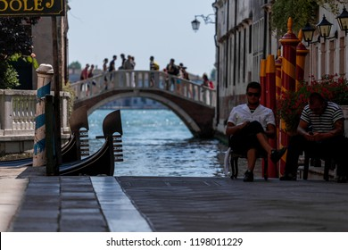 Italy, Venice, August 22, 2010: Gondoliers are waiting for tourists.