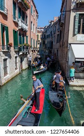 Italy, Venice, August 23, 2010: Gondoliers ride tourists.