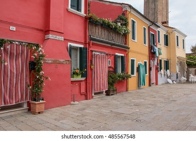 Italy. Venice. Burano .Red and yellow house with a door and a balcony. 5 september 2016