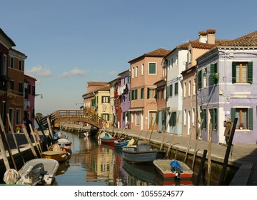 Italy, Venice, colorful houses on a canal on the island of Burano