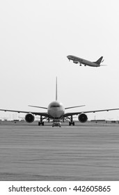 Italy, Venice, Venice International Airport; 14 September 2011, airplane on  the runway and another on takeoff- EDITORIAL
