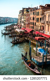 ITALY, VENICE - JANUARY 4, 2019: Grand Canal, gondolas at the pier, old architecture, bright beautiful water.