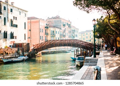 ITALY, VENICE - JANUARY 5, 2019: Morning view of a large wooden bridge along the canal of Venice.