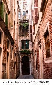 ITALY, VENICE - JANUARY 5, 2019: Old narrow residential street in Venice.