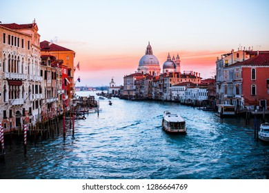 ITALY, VENICE - JANUARY 5, 2019: Venice in the sunset, a beautiful view of the Cathedral of St. Mary of the Sea, saluting architecture, boats.