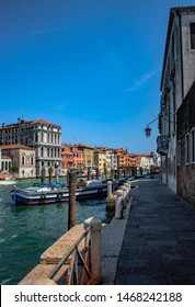 Italy, Venice - Jule 31, 2018: Venetian canals, narrow promenade of Venice, Italy, streets overlooking blue sky. - Filter applied in post-production by Yevheniy Myakiy
