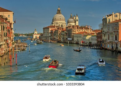 Italy, Venice, top view of the Grand Canal, Saint Mary of Health and boats in sunny weather