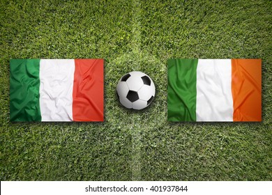 Italy vs. Ireland flags on green soccer field