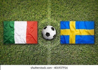 Italy vs. Sweden flags on green soccer field