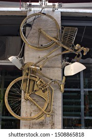 Italy: Yellow hanging bicycle .