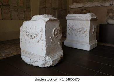 ITALY,BRESCIA - 26 June 2019: decorations of the ruins of the Capitolum of Brixia, a temple dedicated to the Capitoline Triad -Jupiter, Juno and Minerva. Brixia Archaeological Park of Brescia Romana