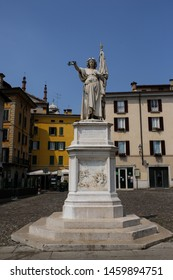ITALY,BRESCIA 26 June 2019: monument to Bella Italia,erected by the sculptor Giovanni Battista Lombardi in 1864 o nthe north-eastern branch of the square houses Piazza della Loggia,Square della Loggia
