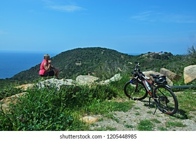 Italy-view on cyclist near village Colle D´orano on the island of Elba