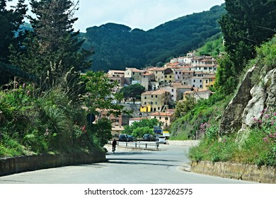 Italy-view on the cyclist and town Rio Nell´elba on the island of Elba