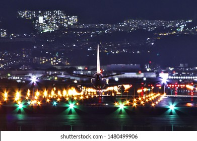 At Itami Airport in Osaka. / Japan - August 11, 2019. : Night view of a jet plane just before takeoff.