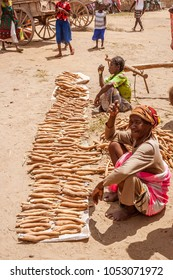 ITAMPOLO, MADAGASCAR, OCT 19: Malagasy women of Antandroy ethnic group selling cassava at weekly market of Itampolo in the great south of Madagascar on october 19, 2016.