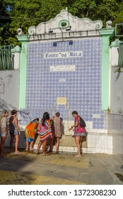 Itaparica island, Brazil - 4 February 2019: people drinking water of colonial fountain at Itaparica island on Brazil