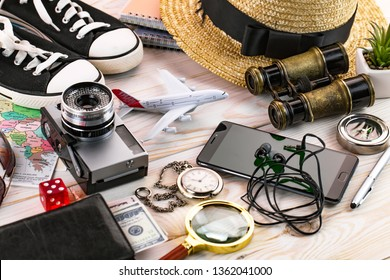 items and accessories for the traveler on the old background on the table