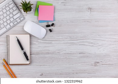 Items for business on a light background on the table, view from the top