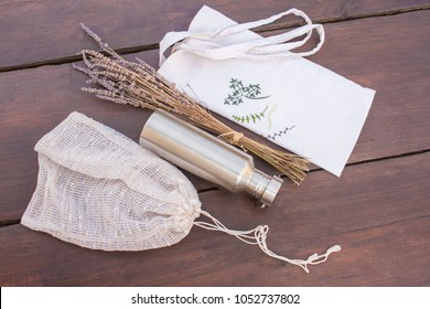 Items necessary for plastic free, zero waste/less waste shopping and living. Reusable, recycled, homemade produce bag for fruit or vegetables, a textile bag and a durable stainless steel bottle.
