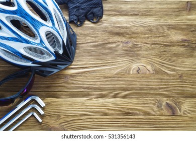Items replacements and tools for a safe cycling: Helmet, gloves, glasses, wrench, flat lay. Top view. Tools and accessories set for cycling with copy space.