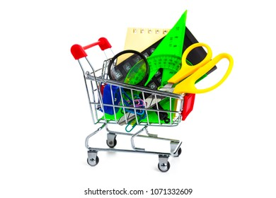 Items for school in a shopping cart isolated on a white background. Concept of buying items for school. Back to school.
