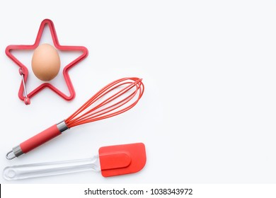Items for scrambled eggs and omelets, desserts, bakery. Egg, corolla, silicone spatula, silicone mold. The concept of cooking breakfast. Flat lay, copy space, top view