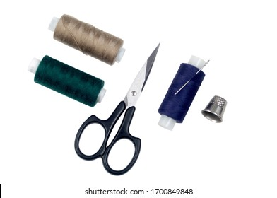 Items for sewing: needle, scissors, threads and thimble. Isolated on white