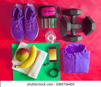 items for workout or exercise placed on the wooden floor