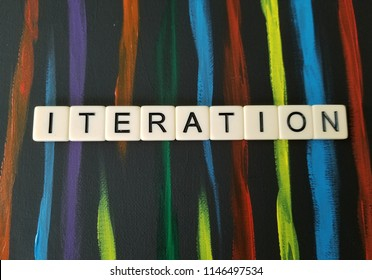 Iteration in letters on black and multi colored background