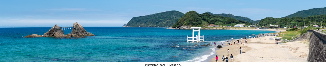 Itoshima. Japan. 28 august 2018 tourists visiting the wedded rocks and white Torii at Futamigaura beach