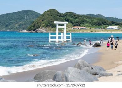 Itoshima. Japan. 28 august 2018 tourists visiting the white Torii at Futamigaura beach