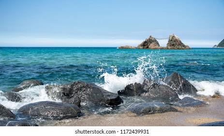 Itoshima. Japan. 28 august 2018 Waves Crashing against Rocks in front of  wedded rocks at Futamigaura beach