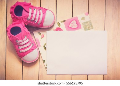 It`s a girl card. Pink shoes next to white card for text.