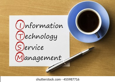 ITSM - Information Technology Service Management - handwriting on notebook with cup of coffee and pen, acronym business concept