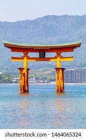 "Itsukushima Floating Torii Gate located in Miyajima Island, Japan.  Japanese characters on the gate's plate translate as ""itsukushima shrine""."