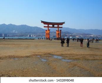 Itsukushima Island, Japan, April 3, 2019. View of Torii Gate from Itsukushima Shinto Shrine, Itsukushima Island, Japan at Low Tide
