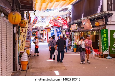 Itsukushima, Japan- september 19, 2018: Traditional path full of food and souvenir stalls in Itsukushima Shrine Village