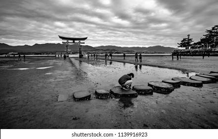 Itsukushima shrine, Miyajima(Itsukushima) Island, Hiroshima prefecture, Chūgoku(San'in-San'yō) region, Japan, January 2017: Just a few minute stop