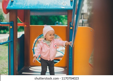 a ittle girl playing in the Playground