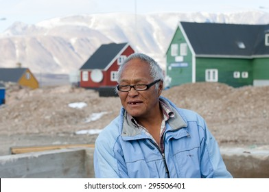 ITTOQQORTOORMIIT, GREENLAND - SEPTEMBER 9, 2012: Old man living in this small town on the eastern side of the island. The main economy is whale and polar bear hunting.