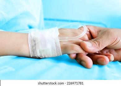 IV solution in a child's patients hand