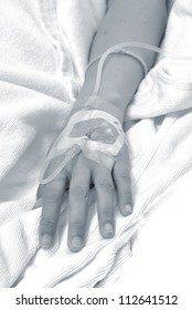 IV solution in a patients hand. Focus on hand