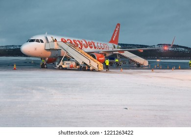 IVALO, FINLAND - DECEMBER 15, 2015: Easyjet airliner boarding at Ivalo, the northernmost airport of Finland. Ivalo is a popular destination for outdoor activites in Lapland.