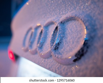 IVALO, FINLAND - January 21, 2019: Close up image of Audi logo placed on Audi A3. Logo and area around are covered with fresh light fluffy snow. Dusk time.