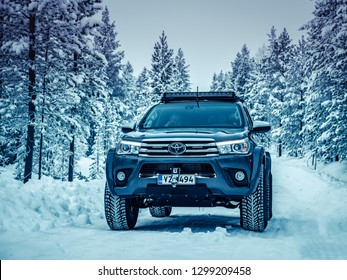 IVALO, FINLAND - January 24, 2019: Toyota Hilux Arctic Trucks AT35 in a polar landscape. This truck accommodates 35 inch winter studded Nokian tyres and is designed for extreme expedition conditions.