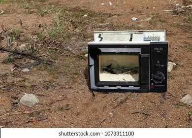 Ivangorod, Russia 20/04/2018, Church yard. Old Toshiba microwave on the ground