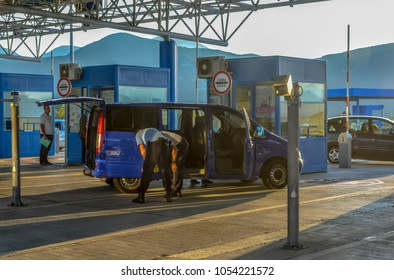 Ivanica, Bosnia and Herzegovina - October 3 2017: A van is stopped and checked by two inspectors at the border crossing at Ivanica between Bosnia and Herzegovina and Croatia.