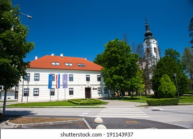 IVANIC-GRAD, CROATIA - May 1, 2014 - Church of st. Peter and city hall in Ivanic-Grad, Croatia.